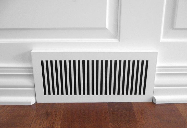 laminated wood baseboard air vent