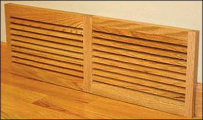 baseboard air vent in wood
